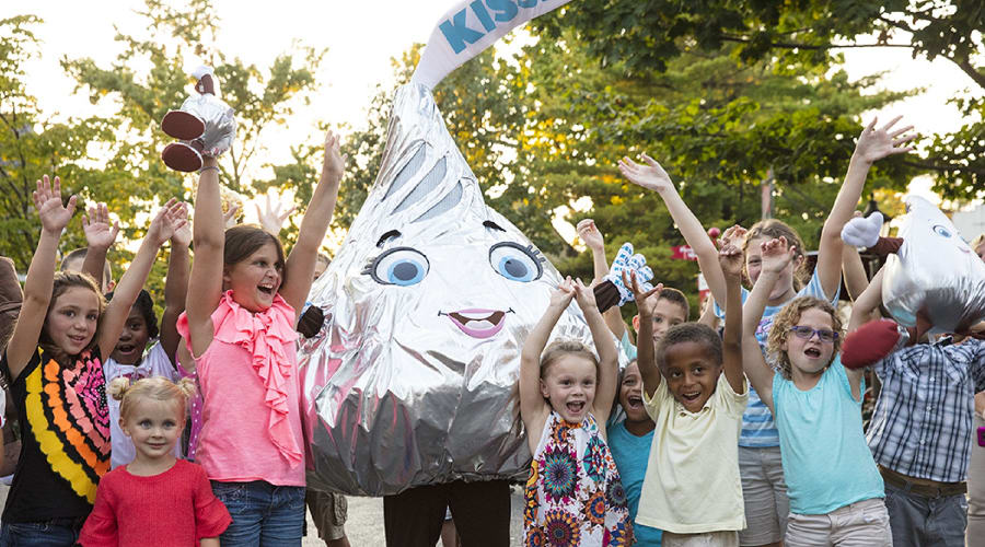 Hershey's Kiss Character at Hersheypark celebrating with happy children