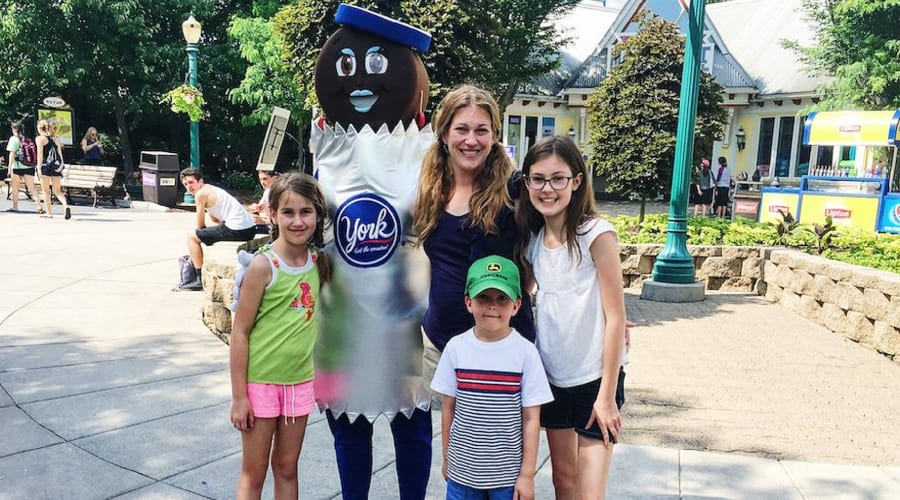 York Peppermint Patty character posing for a picture with family at Hersheypark
