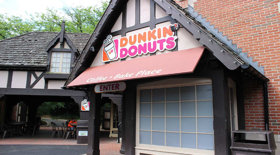 Dunkin Donuts stand along location with entrance sign