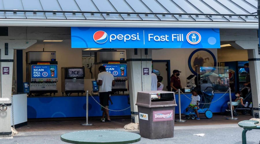 Inside of building with Pepsi machines and queue line