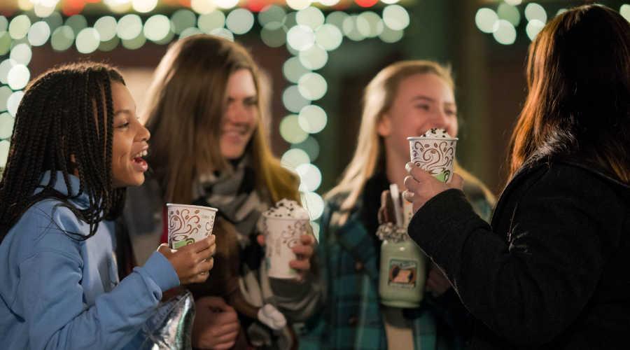 Girls holding hot chocolate