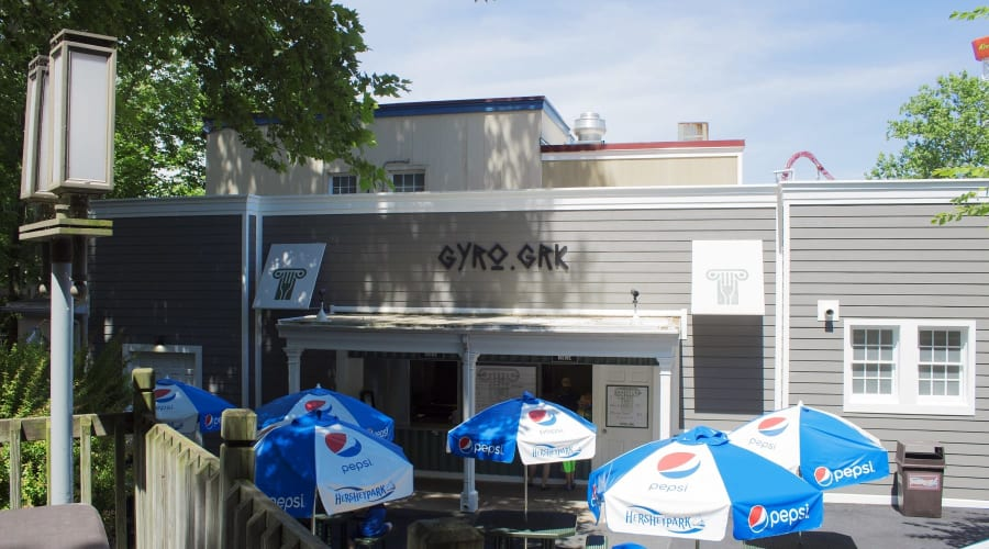 Gyro GRK building with 6 outside tables with umbrellas outside