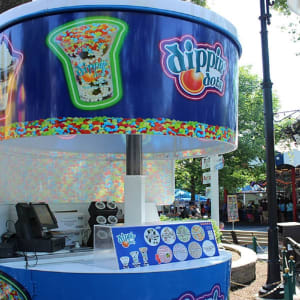 Dippin Dots ice cream stand with photo of menu items