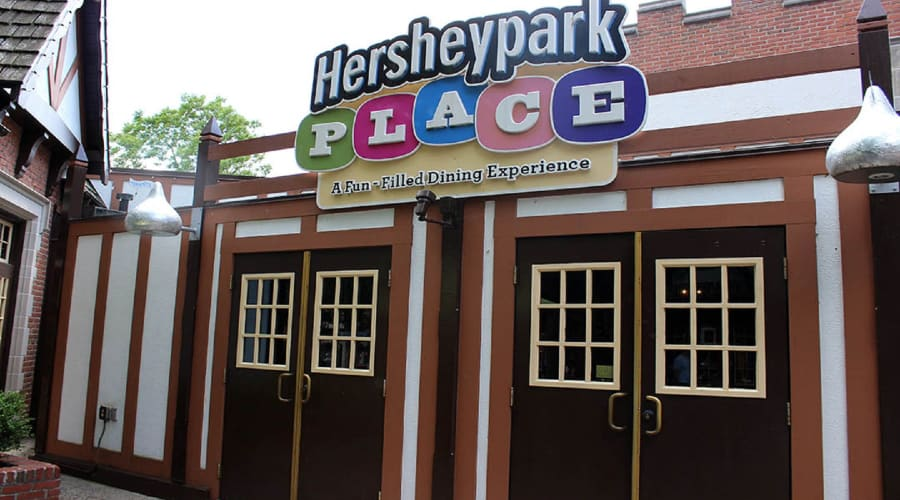 Hersheypark Place sign on a building with two sets of dark brown doors