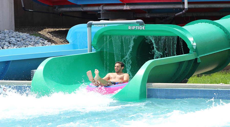 Man riding Coastline Plunge Riptide water slide