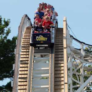 People riding The Comet Wooden Rollercoaster