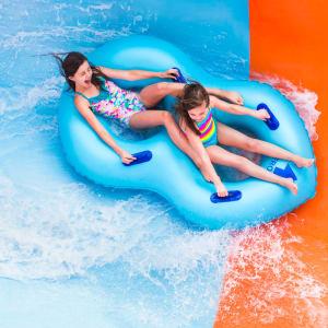 Girls riding Coastline Plunge Vortex water slide