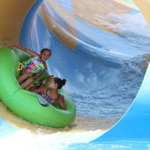 girls riding Coastline Plunge Whirlwind water attraction at Hersheypark