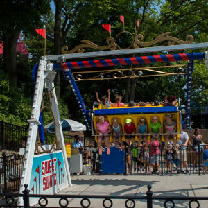 Children riding the Sweet Swing ride at Hersheypark