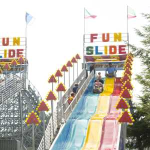 guests sliding down the Merry Derry Dip Fun Slides