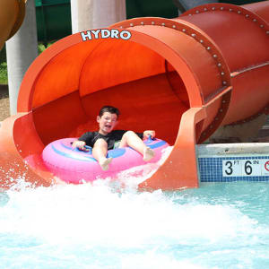 boy riding coastline plunge hydro water slide