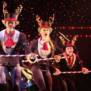 People dressed as reindeer performing