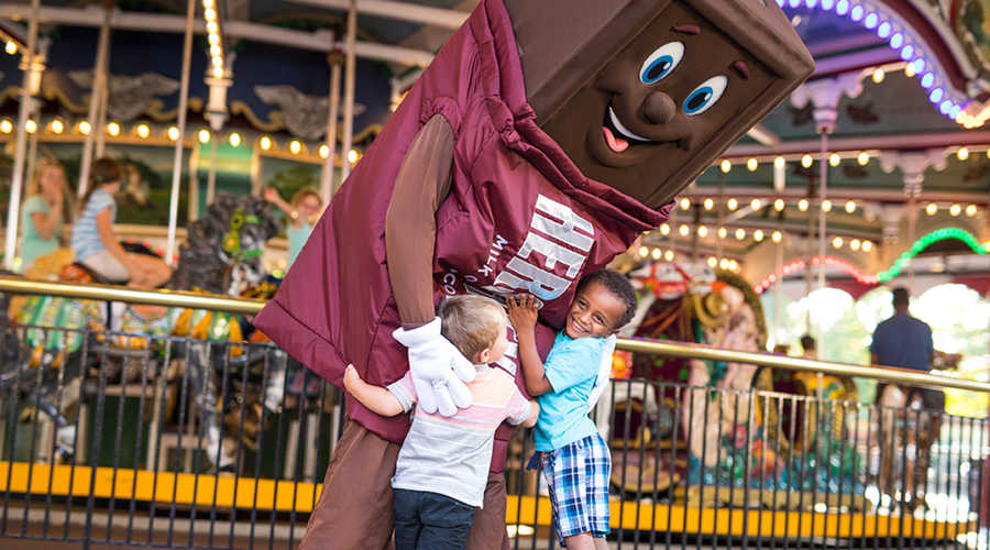 boys hugging Hershey Bar character